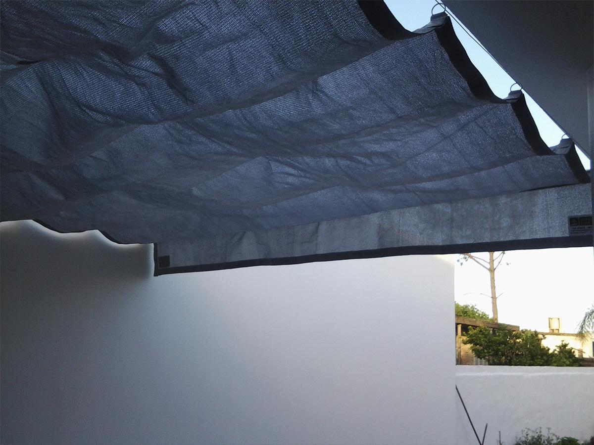Toldos fijos coversol y media sombra for Como hacer una terraza techada